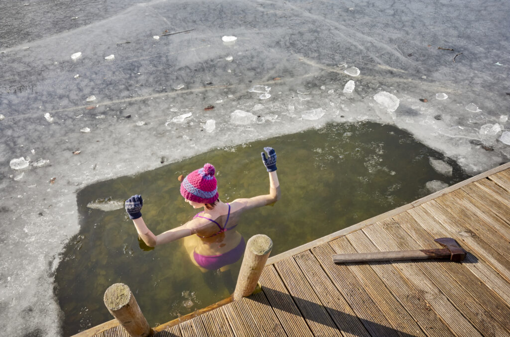 A woman taking a cold plunge.